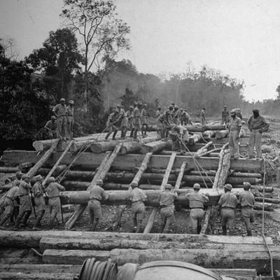 Chinese Engineers Construct a Wooden Bridge by Hand on the Ledo Road, Burma, July 1944 by Bernard Hoffman