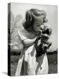 Christina Goldsmith Kissing a Weimaraner Puppy from Her Father's Stock of Weimaraner Hunting Dogs by Bernard Hoffman