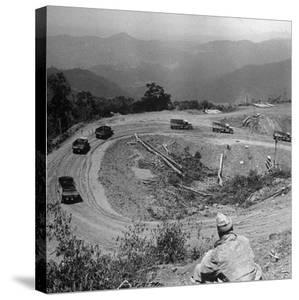 Convoy Cleaning a Block on the Ledo Road Between Hell Gate and Loglai, Burma, July 1944 by Bernard Hoffman