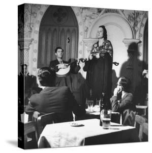 """""""Fado"""" Singer and a Guitarist Entertaining the Audience in the Lisbon Nightclub by Bernard Hoffman"""
