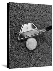Golf Club with Mirror on Head Being Used to Help Accuracy of Golfer's Shot by Bernard Hoffman