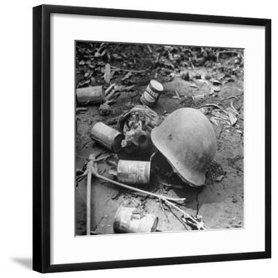 Human Skull, an Army Helmet, and Canned Food by the Side of the Ledo Road, Burma, July 1944