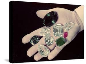 Jeweler Harry Winston Displaying Some of the Famous Gems in His Collection by Bernard Hoffman