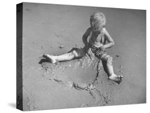 Little Boy Playing on the Beach at Ebb Tide by Bernard Hoffman