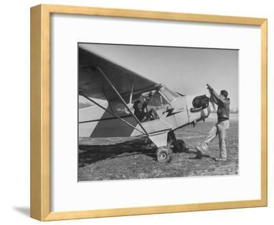 Marie Goerke Sitting in the Plane While the Instructor Kenny Garofalo Stops the Propellor