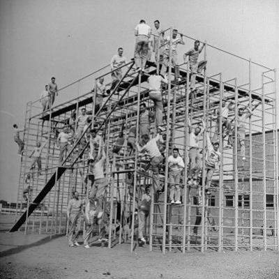 Men Training on the Trainasium Obstalce Coure by Bernard Hoffman