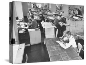 People Working in a Drafting Room by Bernard Hoffman