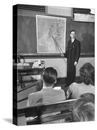 Professor Teaching the Students About Palestine's Geography