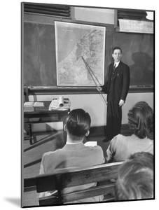 Professor Teaching the Students About Palestine's Geography by Bernard Hoffman