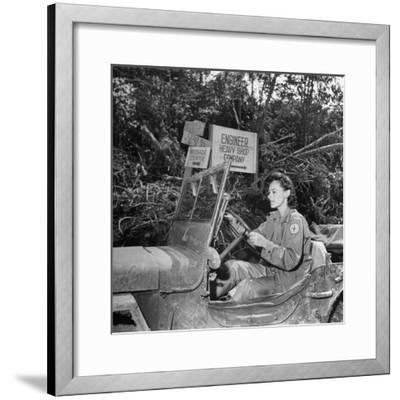 Red Cross Worker Janet Schwerton (Of Newton, Ma) Drives Jeep Along the Ledo Road, Burma, July 1944