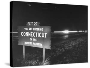 Sign on Merritt Parkway Telling Motorist That They are Now Entering the State by Bernard Hoffman