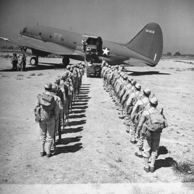 US Armed Forces C46 Cargo Plane Loading Troops and Equipment by Bernard Hoffman