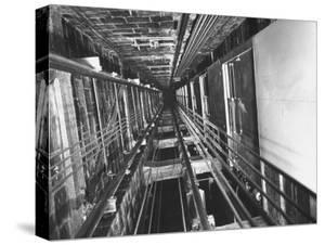 View Looking Up an Elevator Shaft by Bernard Hoffman