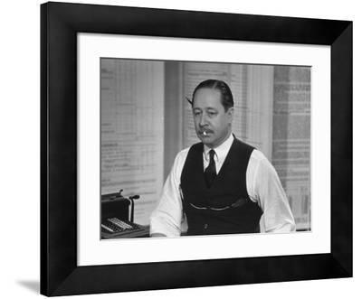 Writer Robert Benchley, Sitting at His Desk with a Small Wade of Paper in His Mouth
