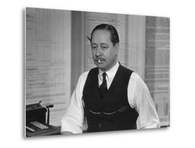 Writer Robert Benchley, Sitting at His Desk with a Small Wade of Paper in His Mouth by Bernard Hoffman