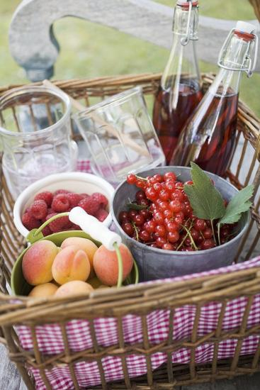 Berries, Apricots, Bottles of Juice and Jars in Basket-Eising Studio - Food Photo and Video-Photographic Print