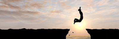 Concept or Conceptual Young Man, Businessman Silhouette Jump Happy from Cliff over Water Gap Sunset