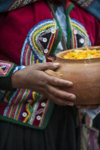 A Quechua Woman Chinchero Style Dress, Carries a Ceramic Bowl of Traditional Stew by Beth Wald