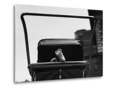 Baby's Feet Peeking out of Carriage