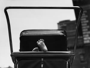 Baby's Feet Peeking out of Carriage by Bettmann