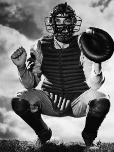 Baseball Catcher Awaiting the Ball by Bettmann