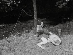 Boy Fishing in the Country by Bettmann