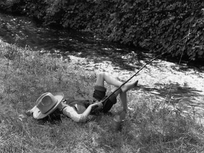 Boy Fishing with Hat Over Face