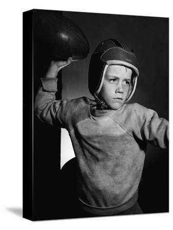 Boy Throwing a Football