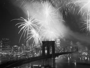Fireworks over the Brooklyn Bridge by Bettmann