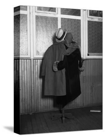 Hanging Coats Posed as an Embracing Couple