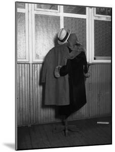 Hanging Coats Posed as an Embracing Couple by Bettmann
