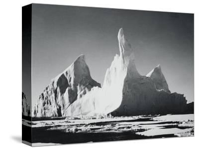 Iceberg Rising From Arctic Waters