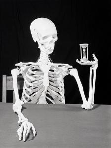 Skeleton Holding Hourglass by Bettmann