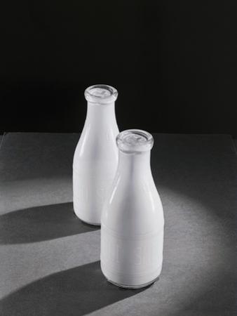 Two Quarts of Milk in Glass Bottles by Bettmann