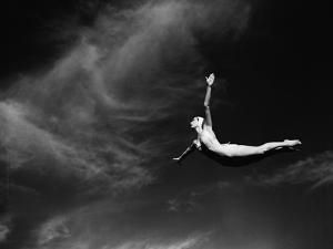 Woman Performing Swan Dive by Bettmann