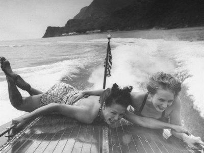 https://imgc.artprintimages.com/img/print/betty-brooks-and-patti-mccarty-motor-boating-at-catalina-island_u-l-p3mf3e0.jpg?p=0