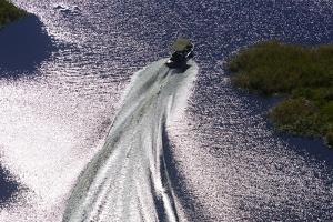 Aerial Shot of a Motor Boat Traveling Through a Channel of Water in the Selinda Reserve by Beverly Joubert