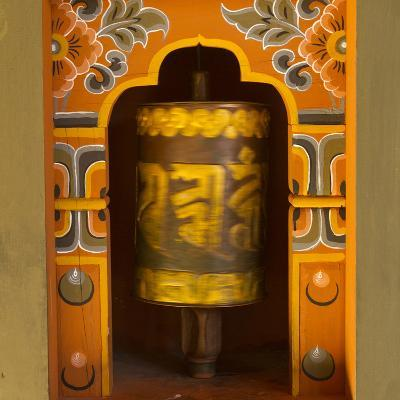 Bhutan. Prayer Wheel Spins in the Wall of a Temple-Brenda Tharp-Photographic Print