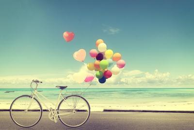https://imgc.artprintimages.com/img/print/bicycle-vintage-with-heart-balloon-on-beach-blue-sky-concept-of-love-in-summer-and-wedding_u-l-q19yrr30.jpg?artPerspective=n
