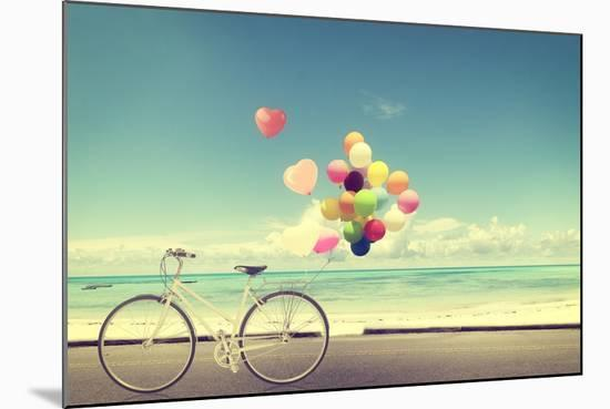 Bicycle Vintage with Heart Balloon on Beach Blue Sky Concept of Love in Summer and Wedding-jakkapan-Mounted Photographic Print