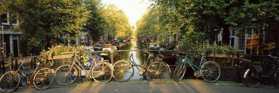 Bicycles on Bridge Over Canal, Amsterdam, Netherlands--Photographic Print