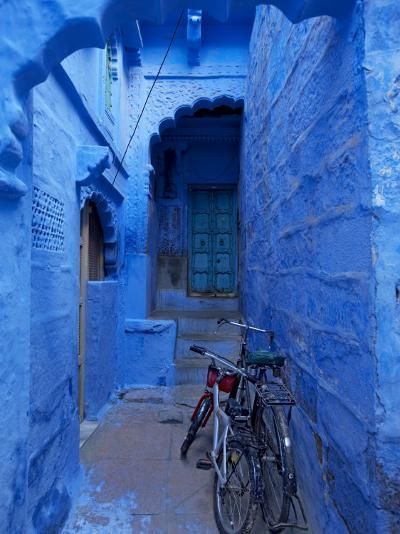 Bicycles Parked in Blue-Painted Laneway-Johnny Haglund-Photographic Print