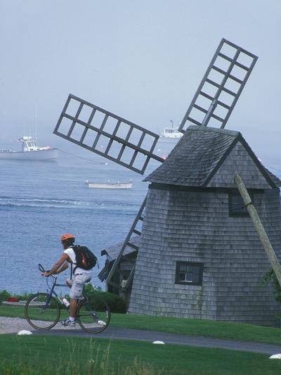 Bicyclist Rides Past a Windmill on a Cape Cod Shore, Chatham, Massachusetts-Darlyne A^ Murawski-Photographic Print