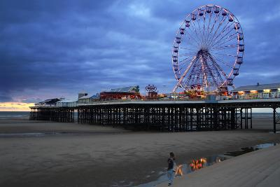 Big Wheel and Amusements on Central Pier at Sunset with Young Women Looking On, Lancashire, England-Rosemary Calvert-Photographic Print