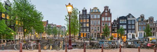 Bikes and Houses Along Canal at Dusk at Intersection of Herengracht and Brouwersgracht--Photographic Print