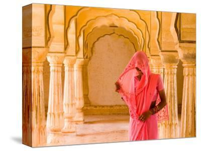 Arches with Hindu Woman at Amber Fort Temple, Rajasthan, Jaipur, India