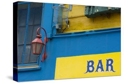 Buenos Aires, Argentina. La Boca Colorful Street with Murals Out Window of Bar of Building