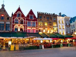Cafes in Marketplace in Downtown Bruges, Belgium by Bill Bachmann