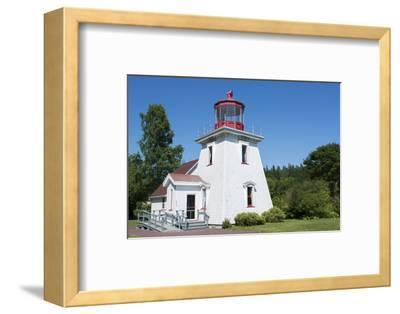 Canada, St. Martins, New Brunswick, White Tourist Lighthouse in Small Fishing and Lobster Village