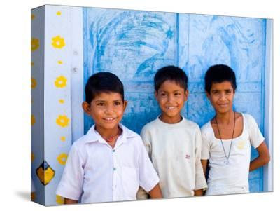 Children Against Blue Wall in Jaipur, Rajasthan, India